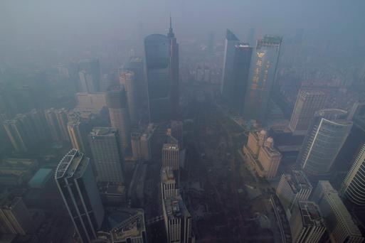 Buildings are seen through thick haze at the central business district in Guangzhou, Guangdong province in China. Worldwide, emissions have averaged a 2.7 per cent annual increase