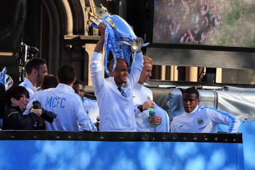 Manchester City's Vincent Kompany lifts the Premier League Trophy