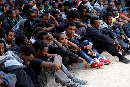A group of illegal emigrants are detained after Libyan coast guards caught them attempting to flee the coast to Europe, in Zawia, west of Tripoli, May 12, 2014. REUTERS/Ismail Zitouny (LIBYA - Tags: POLITICS CIVIL UNREST SOCIETY IMMIGRATION CRIME LAW)
