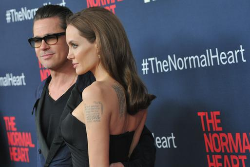"Brad Pitt and Angelina Jolie attend the New York premiere of ""The Normal Heart"" at Ziegfeld Theater"