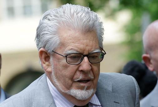 Rolf Harris arrives at Southwark Crown Court in London, Tuesday, May 13, 2014.