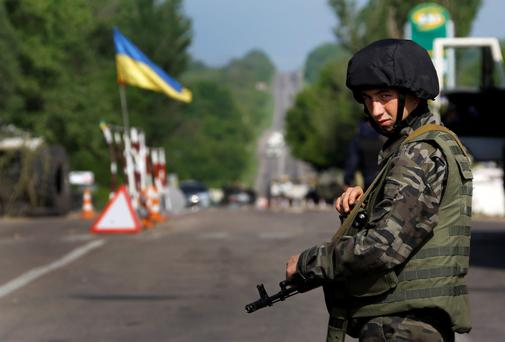 An Ukrainian army soldier mans a road-block north of the eastern Ukrainian town of Slaviansk, May 13, 2014.