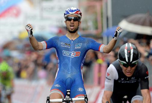 France's Nacer Bouhanni celebrates as he crosses the finish line to win the fourth stage of the Giro d'Italia, from Giovinazzo to Bari, Italy