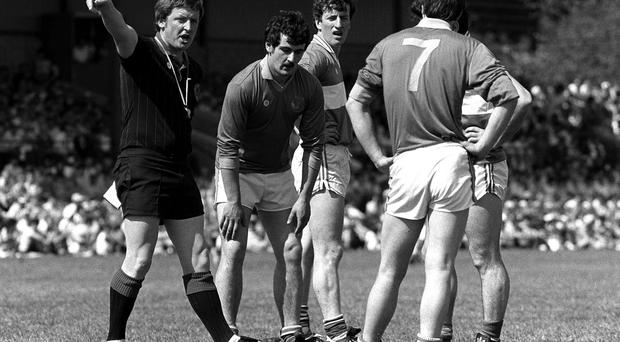 Referee Carthage Buckley sends off Wicklow's Nick O'Neill and Laois's Willie Brennan during the 1986 Leinster SFC at Aughrim. Photo: Ray McManus / SPORTSFILE