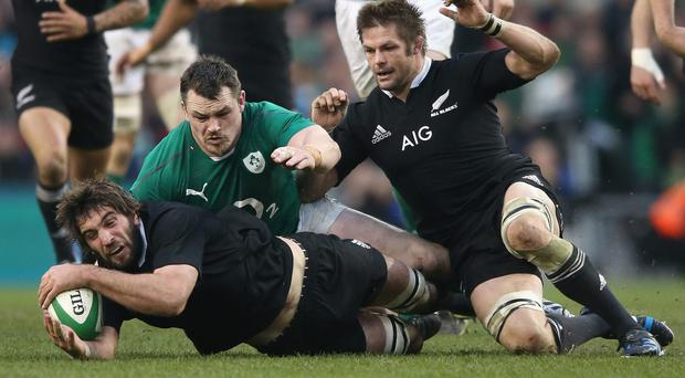 Sam Whitelock of the All Blacks races Cian Healy and team mate Richie McCaw to the loose ball during the International match between Ireland and New Zealand All Blacks at the Aviva Stadium in Dublin, Ireland. (Photo by David Rogers/Getty Images)