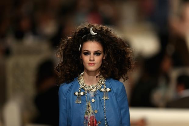 A model walks the runway at the Chanel Cruise Collection 2014/2015 at The Island