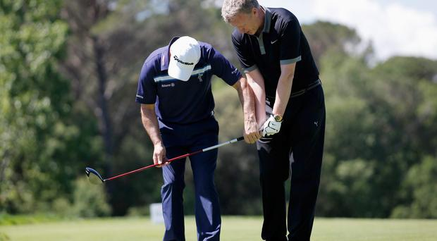 Paul McGinley of Ireland gives swing advice or tips to Former Manchester United Manager, David Moyes during the Open de Espana ProAm at PGA Catalunya Resort in Girona, Spain. (Photo by Dean Mouhtaropoulos/Getty Images)