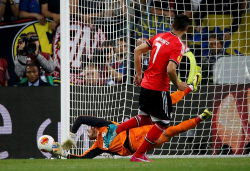 Sevilla's goalkeeper Beto saves a penalty shot by Benfica's Oscar Cardozo