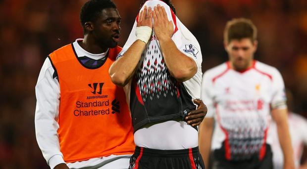 Kolo Toure of Liverpool consoles the dejected Luis Suarez of Liverpool following their team's 3-3 draw during the Barclays Premier League match between Crystal Palace and Liverpool at Selhurst Park. (Photo by Clive Rose/Getty Images)