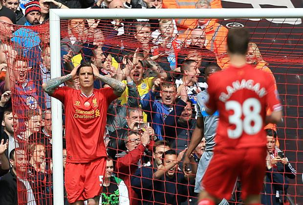 Liverpool's Daniel Agger rues a missed chance during the Barclays Premier League match at Anfield, Liverpool. Peter Byrne/PA Wire.