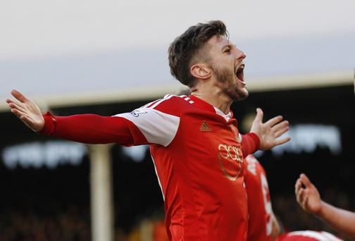 Southampton's English midfielder Adam Lallana celebrates scoring a goal during the English Premier League football match between Fulham and Southampton at Craven Cottage. IAN KINGTON/AFP/Getty Images)