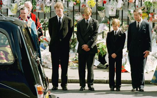 Prince Charles (R) with his two sons Prince Harry (2ndR) and Prince William (3rdR) and Diana's brother Earl Spencer bow their heads as they watch the hearse bearing the coffin of Diana, Princess of Wales leave Westminster Abbey REUTERS