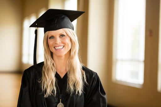 ORLANDO, FL - MAY 10: In this handout photo provided by Rollins College, Elin Nordegren receives the Hamilton Holt Outstanding Senior Award for the Class of 2014 during her graduation from Rollins College on May 10, 2014 in Orlando, Florida. (Photo by Scott Cook for Rollins College via Getty Images)