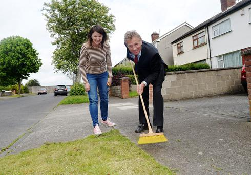 Senator Eamonn Coghlan helps local resident Claire Richardson during canvassing in Edgewood Lawns, Corduff, Dublin. Picture: Caroline Quinn