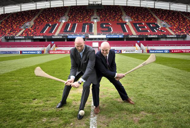 Rugby legends Lawrence Dallaglio and Keith Wood have some fun at the 2014 Sports Tourism European Summit in Thomond Park, Limerick, yesterday. Picture: STEVE HUMPHREYS