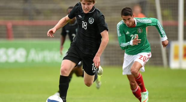 Ireland U19's Jack Hallahan gets away from Mexico U20's Mauro Lainez during the international underage friendly at Dalymount Park