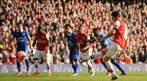 Arsenal's Mikel Arteta scores from the spot