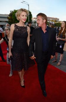 Actress Charlize Theron and actor Sean Penn attend the premiere of Universal Pictures and MRC's