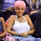 Rihanna attends an NBA playoff game between the Oklahoma City Thunder and the Los Angeles Clippers at Staples Center
