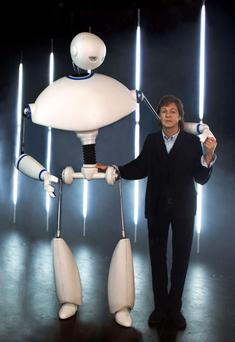 Paul McCartney with Newman the robot, who was created by the team behind War Horse, in his new video. Photo: Mary McCartney/PA Wire