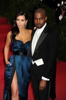 Kim Kardashian and Kanye West arriving at the Met Gala event at the Metropolitan Museum of Art in New York, USA. PRESS ASSOCIATION Photo. Picture date: Monday May 5, 2014. Photo credit should read: Dennis Van Tine/PA Wire