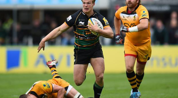 Tom Stephenson of Northampton Saints avoids the challenges of Ed Jackson and Andy Goode of London Wasps
