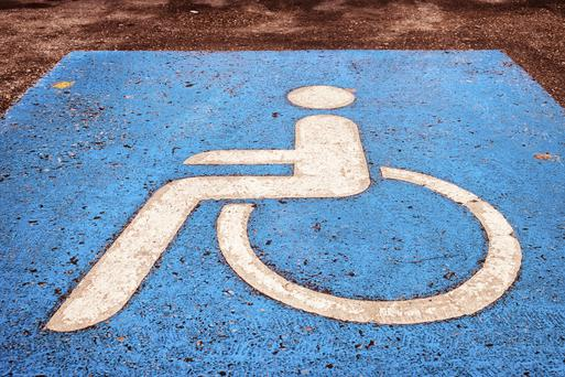 A TEENAGER has been banned from driving for five months for parking across two disabled spaces