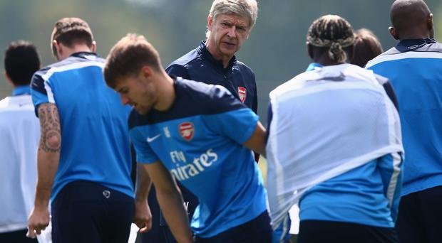 Arsene Wenger keeps a close eye on his team ahead of today's FA Cup final at Wembley