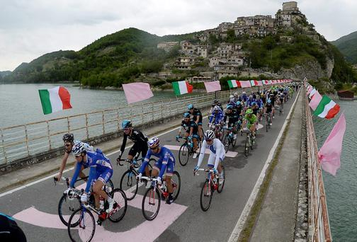 The peloton crosses a bridge during the seventh stage of the Giro d'Italia, from Frosinone to Foligno