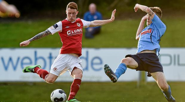 Lee Lynch, St Patrick's Athletic, in action against Colin Crowe, UCD