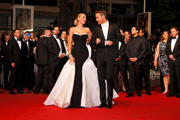 Cast member Ryan Reynolds (R) and his wife actress Blake Lively arriving for the screening of the film