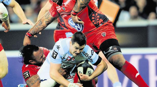 Racing Metro 92's Jonathan Sexton (C-down) holds the ball under pressure from RC Toulon's Mathieu Bastareaud during the French Top 14 rugby union playoff match between RC Toulon and Racing Metro 92, at the Pierre Mauroy stadium in Lille, northern France, on May 16, 2014. AFP PHOTO / FRANCOIS LO PRESTI (Photo credit should read FRANCOIS LO PRESTI/AFP/Getty Images)