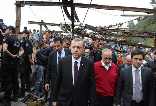 Turkey's Prime Minister Tayyip Erdogan (C) visits the coal mine accident site in Soma, a district in Turkey's western province of Manisa May 14, 2014. Hopes faded of finding more survivors in a coal mine in western Turkey on Wednesday, where 238 workers were confirmed killed and 120 more still feared to be trapped in what is likely to prove the nation's worst ever industrial disaster. REUTERS/Kayhan Ozer/Prime Minister's Press Office/Handout via Reuters (TURKEY - Tags: DISASTER ENERGY POLITICS TPX IMAGES OF THE DAY) ATTENTION EDITORS - NO SALES. NO ARCHIVES. FOR EDITORIAL USE ONLY. NOT FOR SALE FOR MARKETING OR ADVERTISING CAMPAIGNS. THIS IMAGE HAS BEEN SUPPLIED BY A THIRD PARTY. IT IS DISTRIBUTED, EXACTLY AS RECEIVED BY REUTERS, AS A SERVICE TO CLIENTS