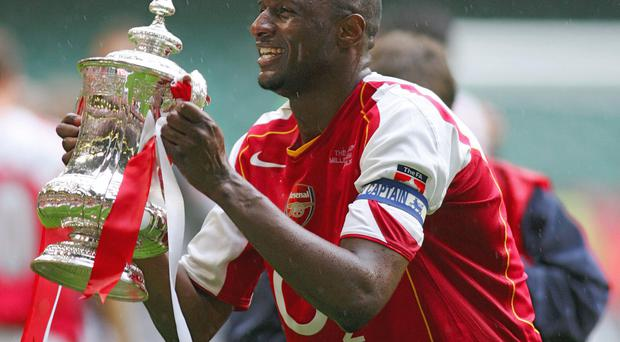 Patrick Vieira lifting the FA Cup after Arsenal defeated Manchester United in the 2005 Final.