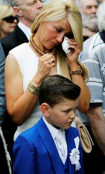 Wendy Doherty and her son Tyler, eight, from Lucan, attend a wreath laying ceremony to mark the 40th anniversary of the Dublin and Monaghan bombings. Wendy who was 1 1/2 years old was with her pregnant mother Collette Doherty who was killed by the explosion. Brian Lawless/PA Wire