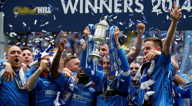 St Johnstone's captain David Mackay lifts the Scottish Cup following their victory over Dundee United in the Scottish Cup final at Celtic Park