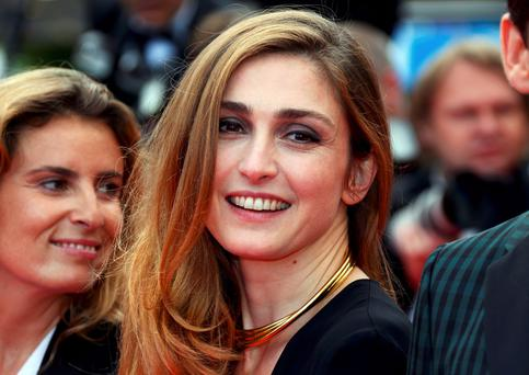 Actress Julie Gayet poses on the red at the 67th Cannes Film Festival in Cannes May 17, 2014. REUTERS/Yves Herman