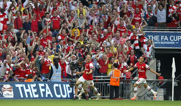 Arsenal's Aaron Ramsey celebrates scoring his side's third goal during the FA Cup Final at Wembley Stadium.