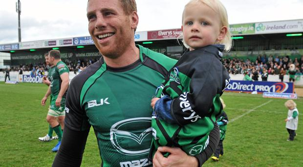 Gavin Duffy, Connacht, with his daughter Jessica, age 2, after he played his last home match for Connacht