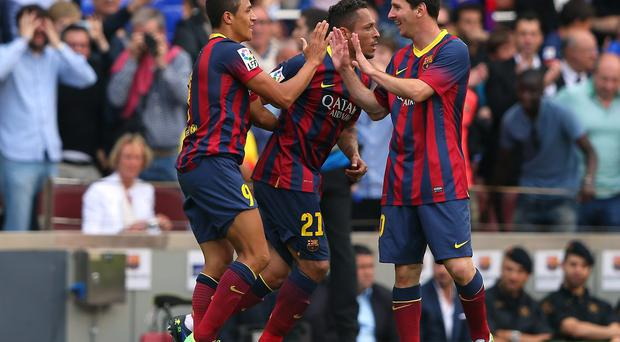 Alexis Sanchez of FC Barcelona celebrates with Lionel Messi after scoring the opening goal