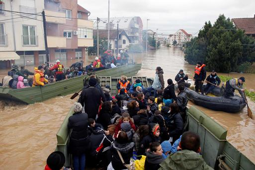 Serbian army soldiers evacuate people in amphibious vehicles in the flooded town of Obrenovac, southwest of Belgrade