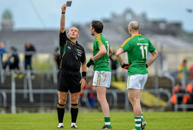 Darren Sweeney, Leitrim, is shown the black card by referee Conor Lane during the first half. Picture credit: Piaras O Midheach / SPORTSFILE
