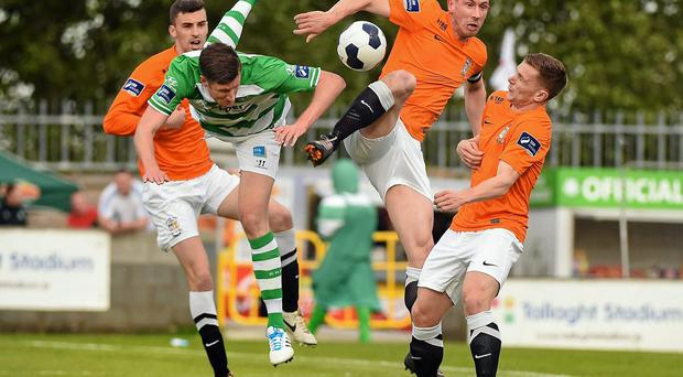 Jason McGuinness, Shamrock Rovers, in action against, from left, Declan Brennan, Alan Byrne and Kealan Dillon, Athlone Town