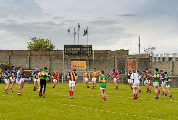 The Louth squad warm up in their club jerseys before the game. Picture credit: Paul Mohan / SPORTSFILE