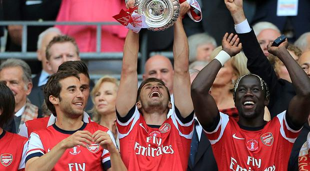Arsenal's Aaron Ramsey (centre) celebrates with the FA Cup trophy