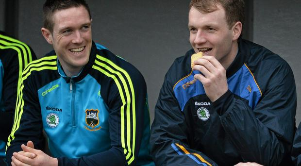 Tipperary's Michael Cahill, left, and Lar Corbett in the dugout before the start of the game. Picture credit: David Maher / SPORTSFILE