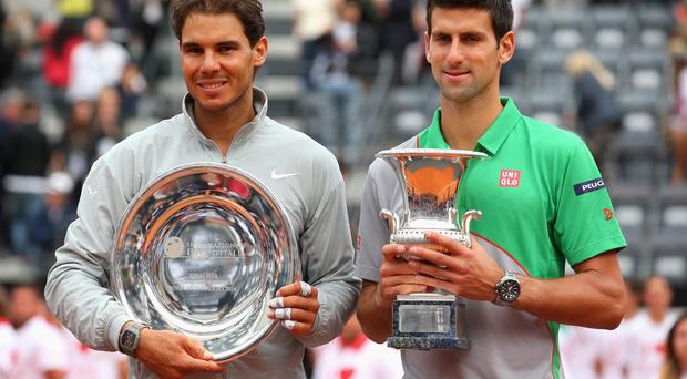 Novak Djokovic of Serbia with the winners trophy next to runner up Rafael Nadal of Spain after the final during day eight of the Internazionali BNL d'Italia tennis in Rome.