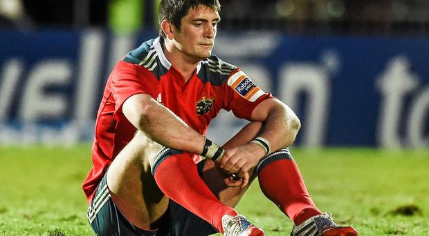 James Downey, showing his disappointment after the Pro12 semi-final defeat to Glasgow Warriors, is leaving Munster