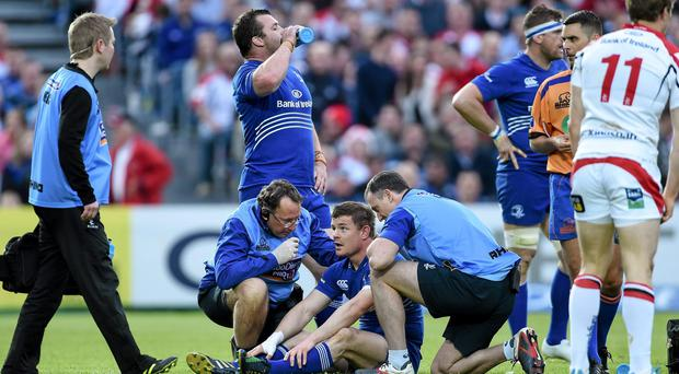 Brian O'Driscoll, Leinster, is spoken to by medical staff before leaving the pitch with an injury. Picture credit: Ramsey Cardy / SPORTSFILE