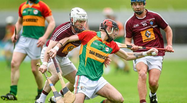Carlow's Gary Kelly in action against Alan Devine, left, and Robbie Greville of Westmeath at Dr. Cullen Park